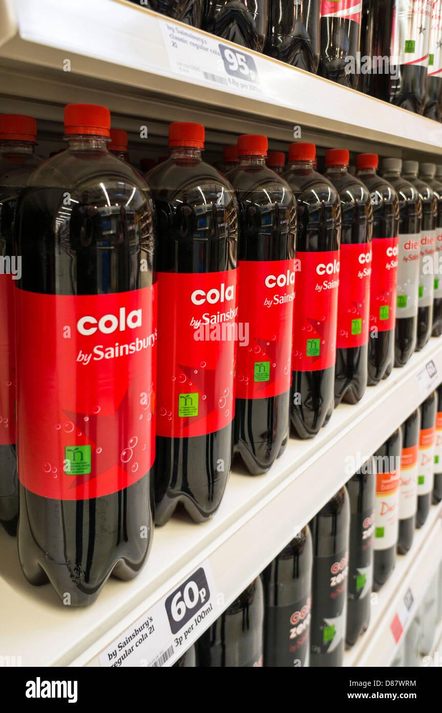 https://c8.alamy.com/comp/D87WRM/sainsburys-own-brand-cola-on-a-supermarket-shelf-D87WRM.jpg
